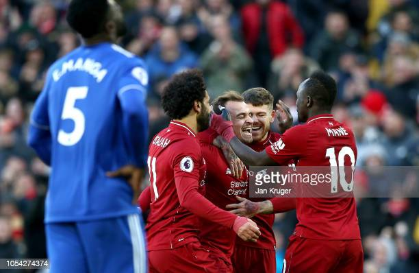 Xherdan Shaqiri of Liverpool celebrates with teammates after scoring his team's third goal during the Premier League match between Liverpool FC and...
