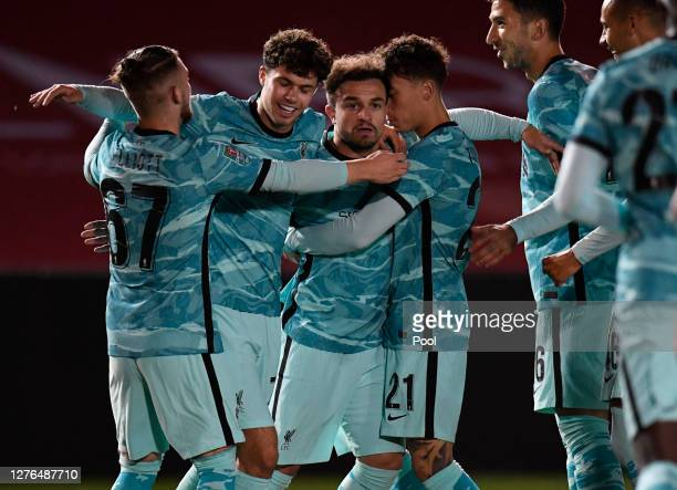 Xherdan Shaqiri of Liverpool celebrates with teammates after scoring his team's first goal during the Carabao Cup third round match between Lincoln...