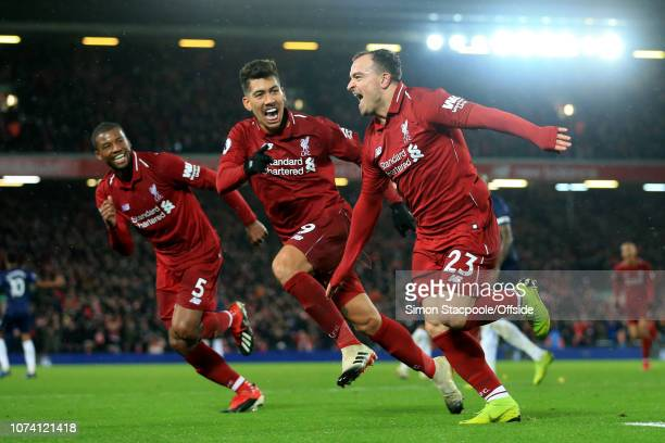 Xherdan Shaqiri of Liverpool celebrates with teammates Roberto Firmino of Liverpool and Georginio Wijnaldum of Liverpool after scoring their 3rd goal...