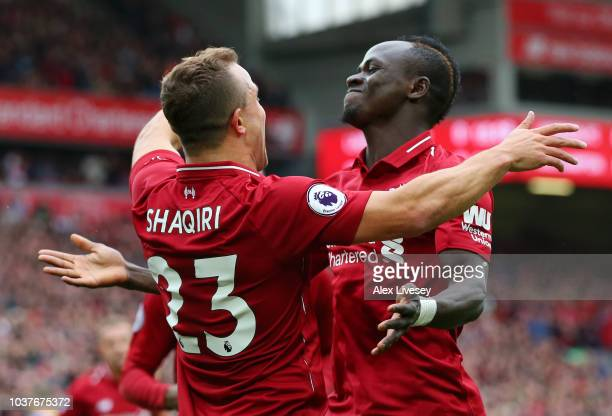 Xherdan Shaqiri of Liverpool celebrates with teammte Sadio Mane after he provides the assist for Liverpool's first goal an own goal by Wesley Hoedt...