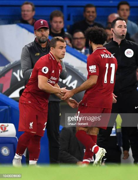 Xherdan Shaqiri of Liverpool comes on as a substitute for Mohamed Salah during the Premier League match between Chelsea FC and Liverpool FC at...