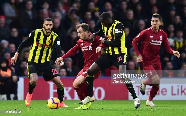 Xherdan Shaqiri of Liverpool is challenged by Abdoulaye Doucoure of Watford during the Premier League match between Watford FC and Liverpool FC at...