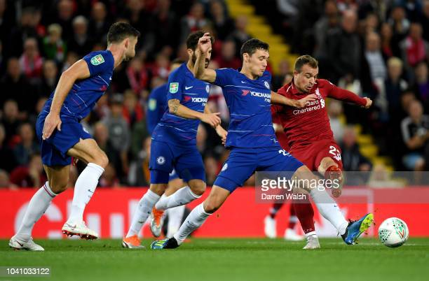 Xherdan Shaqiri of Liverpool is challenged by Andreas Christiansen of Chelsea during the Carabao Cup Third Round match between Liverpool and Chelsea...