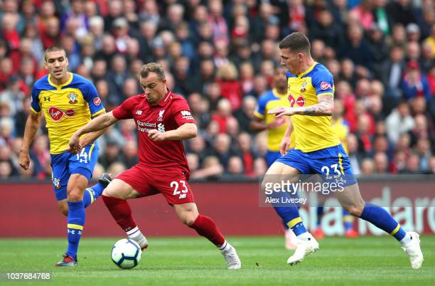 Xherdan Shaqiri of Liverpool runs with the ball under pressure from Oriol Romeu of Southampton and PierreEmile Hojbjerg of Southampton during the...