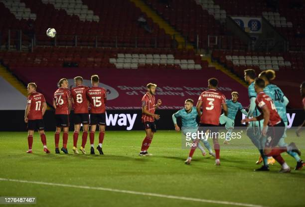 Xherdan Shaqiri of Liverpool scores his team's first goal during the Carabao Cup third round match between Lincoln City and Liverpool at Sincil Bank...