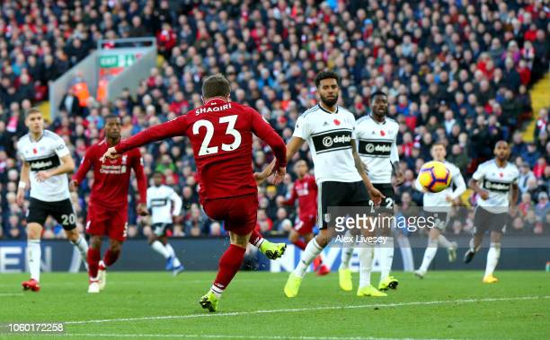 Xherdan Shaqiri of Liverpool scores his team's second goal during the Premier League match between Liverpool FC and Fulham FC at Anfield on November...