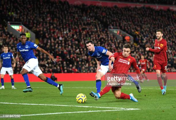 Xherdan Shaqiri of Liverpool scores his team's second goal during the Premier League match between Liverpool FC and Everton FC at Anfield on December...