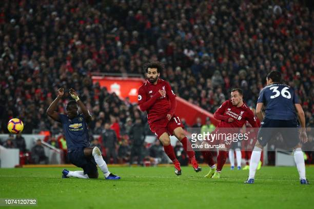 Xherdan Shaqiri of Liverpool scores his team's third goal during the Premier League match between Liverpool FC and Manchester United at Anfield on...
