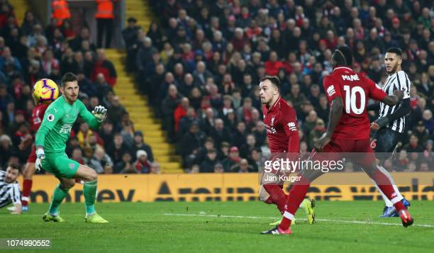Xherdan Shaqiri of Liverpool scores his team's third goal past Martin Dubravka of Newcastle United during the Premier League match between Liverpool...