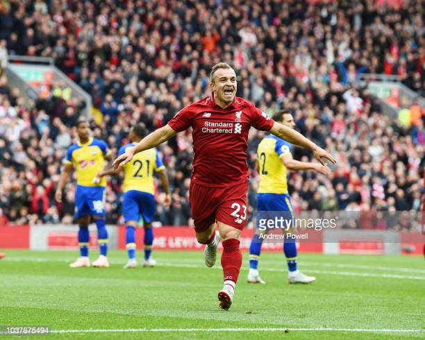 Xherdan Shaqiri of Liverpool scores the opener and celebrates during the Premier League match between Liverpool FC and Southampton FC at Anfield on...