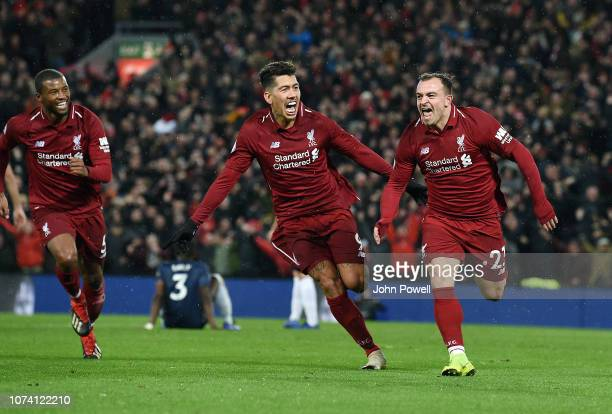 Xherdan Shaqiri of Liverpool Scores the Third goal and celebrates during the Premier League match between Liverpool FC and Manchester United at...