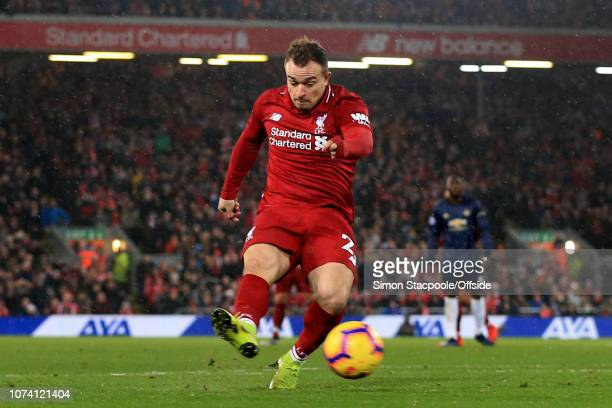 Xherdan Shaqiri of Liverpool scores their 2nd goal during the Premier League match between Liverpool and Manchester United at Anfield on December 16...