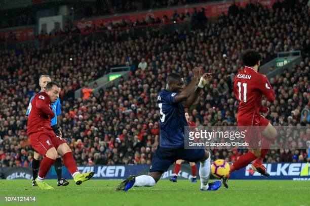 Xherdan Shaqiri of Liverpool scores their 3rd goal during the Premier League match between Liverpool and Manchester United at Anfield on December 16...
