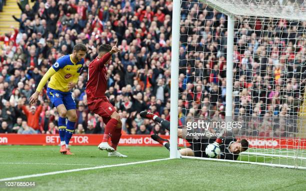 Xherdan Shaqiri of Liverpool shoots the ball Goes in off southampton defender Wesley Hoedt during the Premier League match between Liverpool FC and...