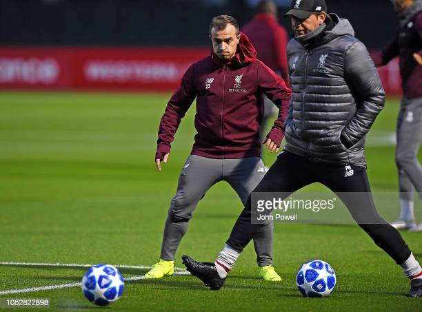 Xherdan Shaqiri of Liverpool with Peter Krawietz seond assistant coach of Liverpool during a training session at Melwood Training Ground on October...