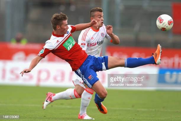 Xherdan Shaqiri of Muenchen battles for the ball with Maximillian Drum of Unterhaching during the friendly match between SpVgg Unterhaching and FC...