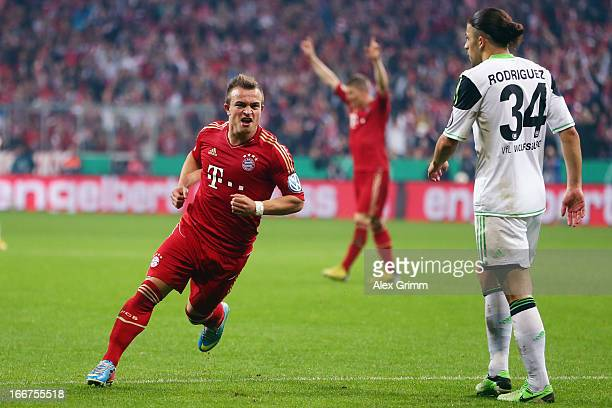 Xherdan Shaqiri of Muenchen celebrates his team's third goal during the DFB Cup Semi Final match between Bayern Muenchen and VfL Wolfsburg at Allianz...