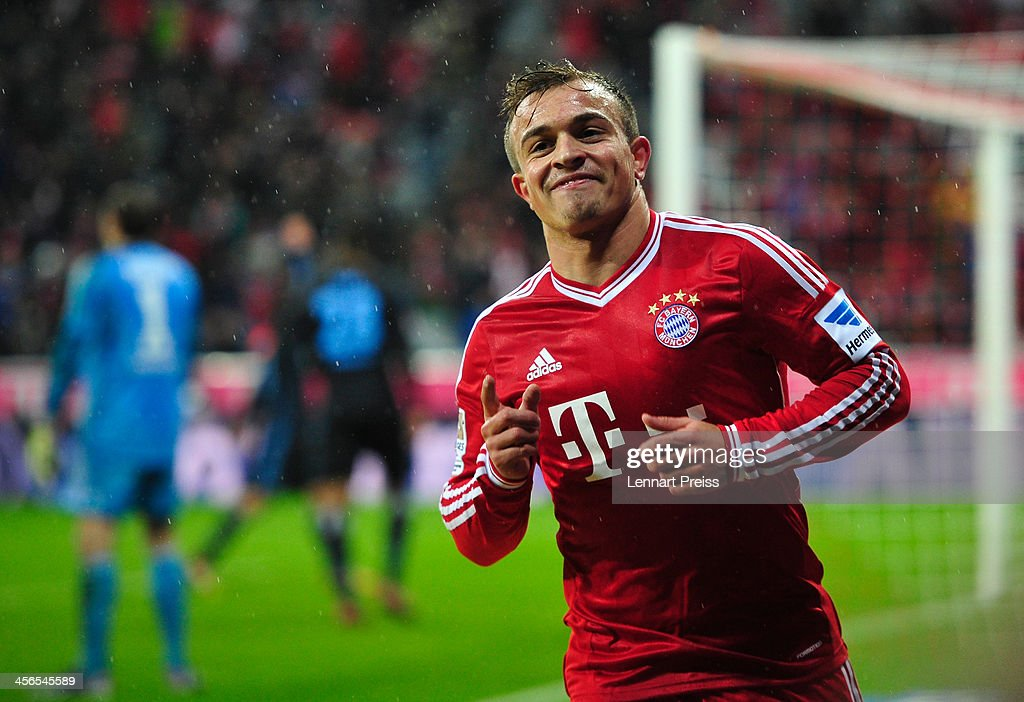 Xherdan Shaqiri of Muenchen celebrates his team's third goal during the Bundesliga match between FC Bayern Muenchen and Hamburger SV at Allianz Arena on December 14, 2013 in Munich, Germany.