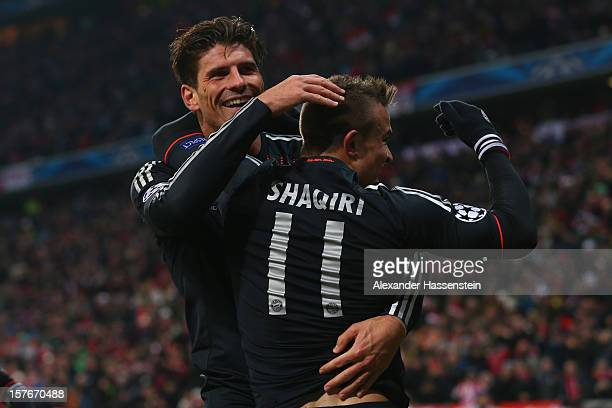 Xherdan Shaqiri of Muenchen celebrates scoring the 3rd team goal with his team mate Mario Gomez during the UEFA Champions League Group F match...