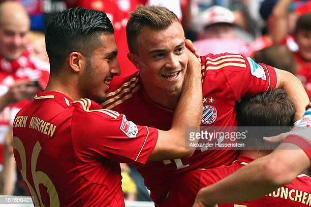 Xherdan Shaqiri of Muenchen celebrates scoring the opening goal with his team mates Emre Can and Rafinha during the Bundesliga match between FC...