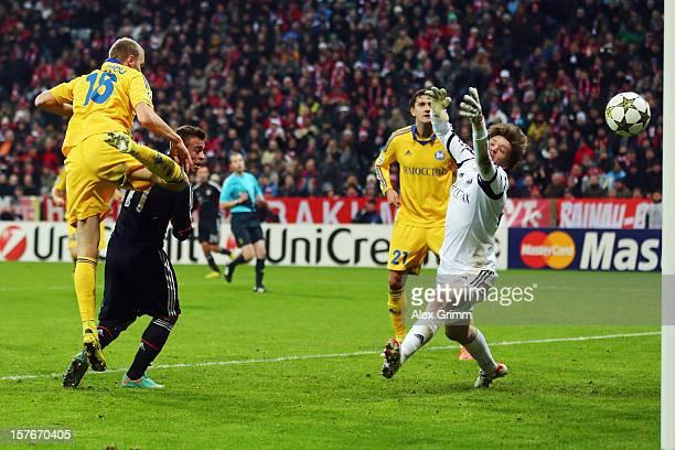 Xherdan Shaqiri of Muenchen scores his team's third goal against Maksim Bordachev and goalkeeper Andrey Gorbunov of Borisov during the UEFA Champions...