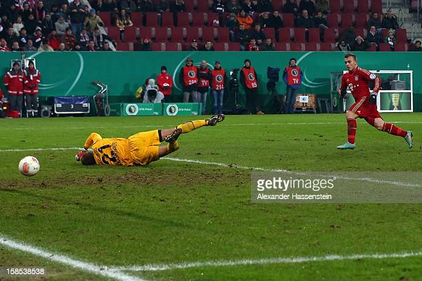 Xherdan Shaqiri of Muenchen scores the 2nd team goal against Alexander Manninger, keeper of Augsburg during the DFB cup round of sixteen match...