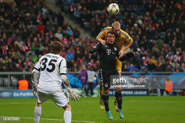 Xherdan Shaqiri of Muenchen scores the 3rd team goal against Maksim Bordachev of Borisov and his keeper Andrei Gorbunov during the UEFA Champions...