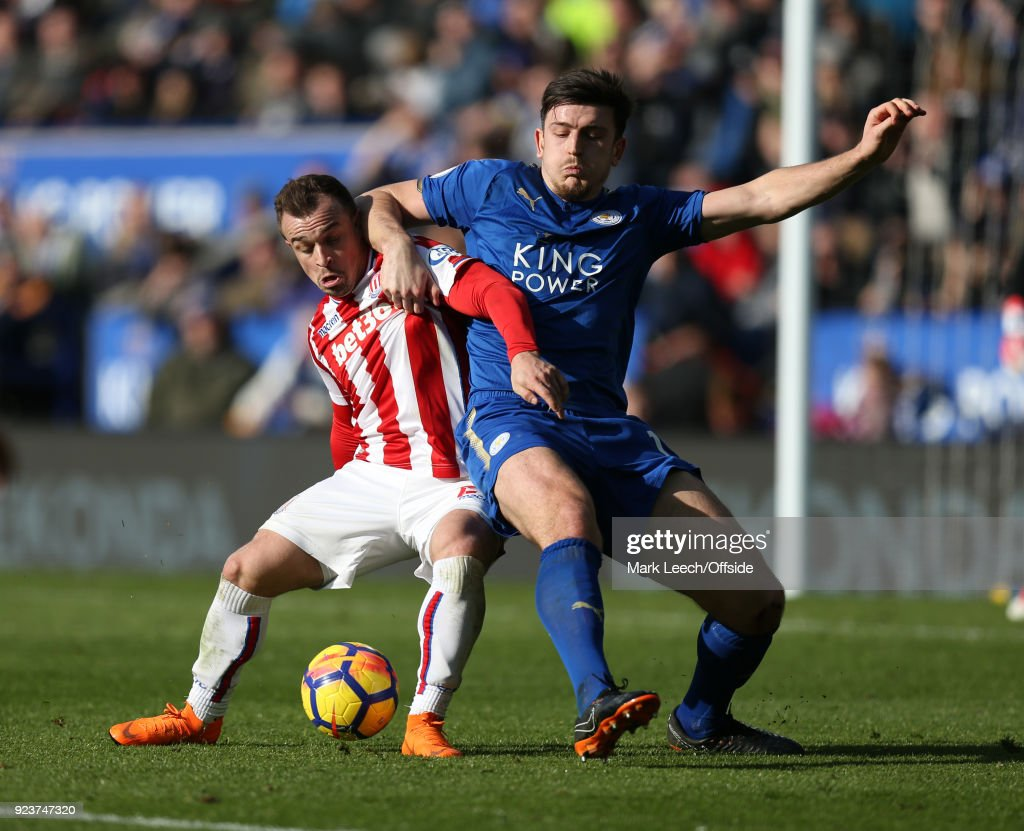 Xherdan Shaqiri of Stoke and Harry Maguire of Leicester during the Premier League match between Leicester City and Stoke City at The King Power Stadium on February 24, 2018 in Leicester, England.