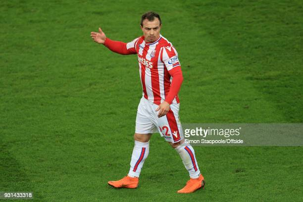 Xherdan Shaqiri of Stoke asks questions during the Premier League match between Stoke City and Manchester City at the Bet365 Stadium on March 12 2018...