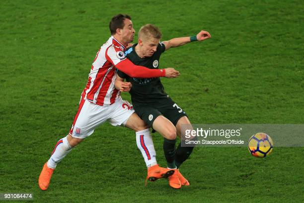 Xherdan Shaqiri of Stoke battles with Oleksandr Zinchenko of Man City during the Premier League match between Stoke City and Manchester City at the...