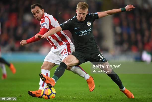 Xherdan Shaqiri of Stoke City and Alexander Zinchenko of Manchester City battle for the ball during the Premier League match between Stoke City and...