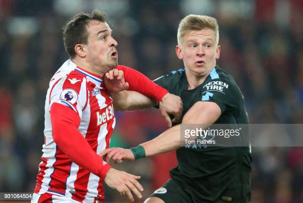 Xherdan Shaqiri of Stoke City and Alexander Zinchenko of Manchester City tussle during the Premier League match between Stoke City and Manchester...
