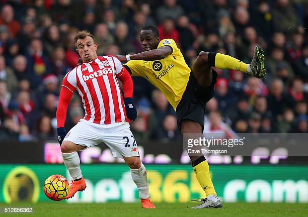 Xherdan Shaqiri of Stoke City and Aly Cissokho of Aston Villa compete for the ball during the Barclays Premier League match between Stoke City and...