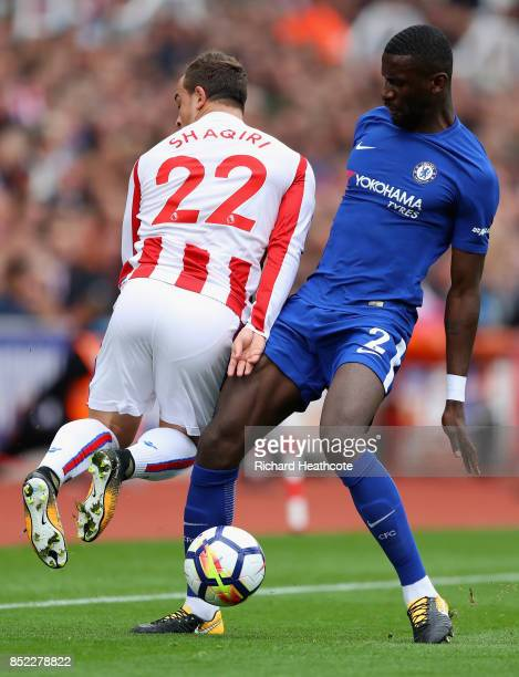 Xherdan Shaqiri of Stoke City and Antonio Rudiger of Chelsea battle for possession during the Premier League match between Stoke City and Chelsea at...