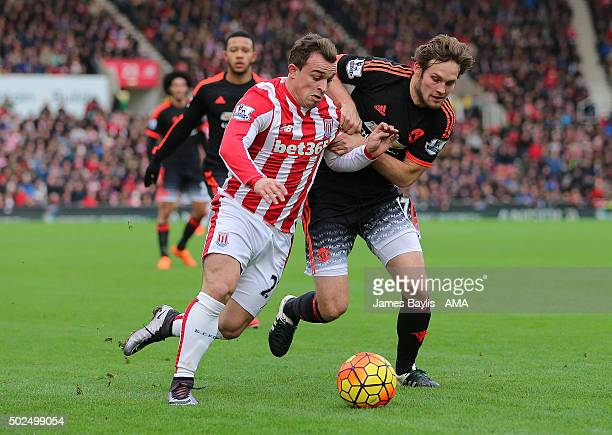Xherdan Shaqiri of Stoke City and Daley Blind of Manchester United during the Barclays Premier League match between Stoke City and Manchester United...