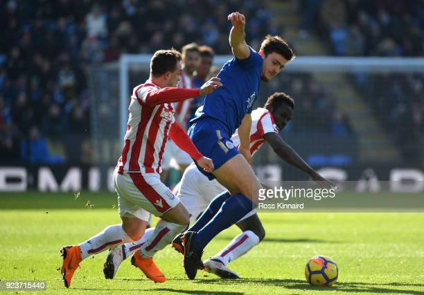 Xherdan Shaqiri of Stoke City and Harry Maguire of Leicester City battle for the ball during the Premier League match between Leicester City and...