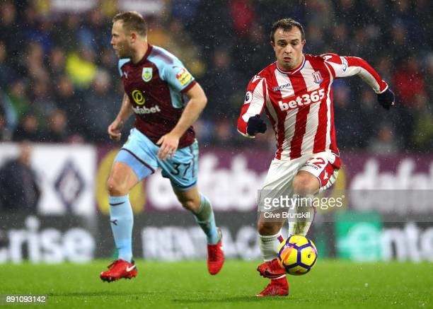 Xherdan Shaqiri of Stoke City and Scott Arfield of Burnley in action during the Premier League match between Burnley and Stoke City at Turf Moor on...