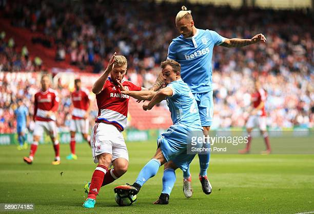 Xherdan Shaqiri of Stoke City battle for possession with Adam Clayton of Middlesbrough during the Premier League match between Middlesbrough and...