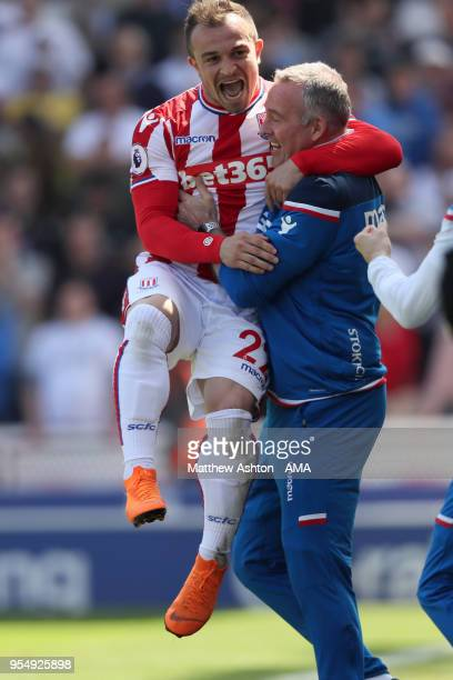 Xherdan Shaqiri of Stoke City celebrates after scoring a goal to make it 10 with head coach / manager Paul Lambert during the Premier League match...