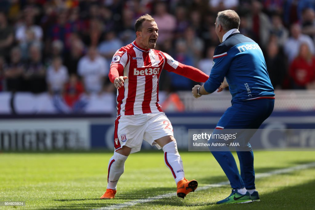 Xherdan Shaqiri of Stoke City celebrates after scoring a goal to make it 1-0 with head coach / manager Paul Lambert during the Premier League match between Stoke City and Crystal Palace at Bet365 Stadium on May 5, 2018 in Stoke on Trent, England.