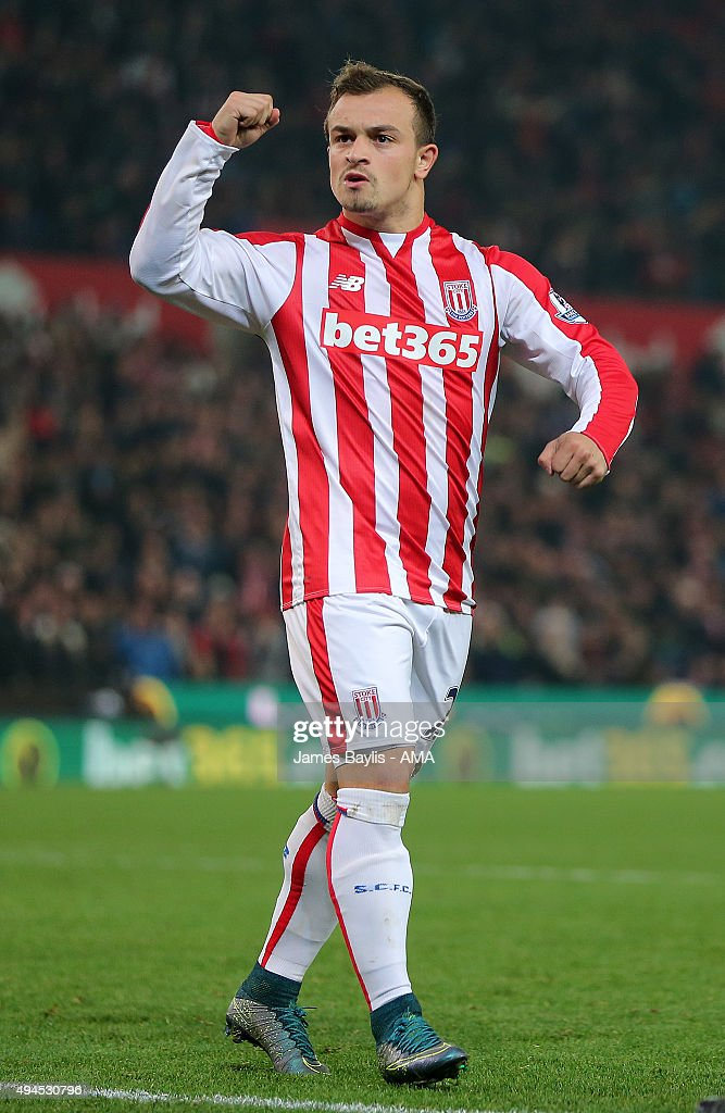 Xherdan Shaqiri of Stoke City celebrates after scoring a penalty during the penalty shoot-out during the Capital One Cup Fourth Round match between Stoke City and Chelsea at Britannia Stadium on October 27, 2015 in Stoke on Trent, England.