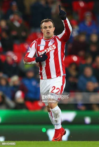 Xherdan Shaqiri of Stoke City celebrates after scoring his sides first goal during the Premier League match between Stoke City and Swansea City at...