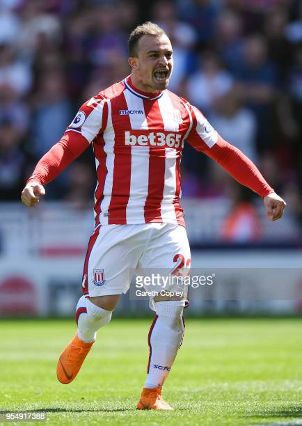 Xherdan Shaqiri of Stoke City celebrates after scoring his sides first goal during the Premier League match between Stoke City and Crystal Palace at...