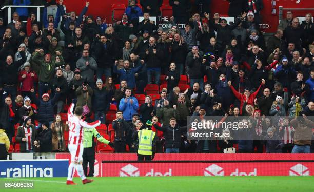 Xherdan Shaqiri of Stoke City celebrates his sides win after the final whistle of the Premier League match between Stoke City and Swansea City at the...