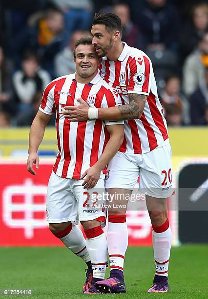 Xherdan Shaqiri of Stoke City celebrates scoring his sides first goal with Geoff Cameron of Stoke City during the Premier League match between Hull...