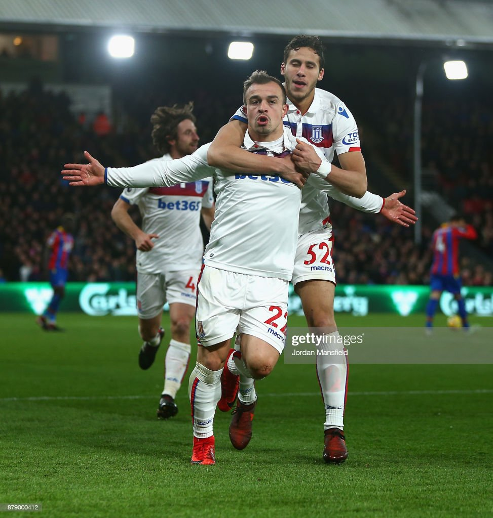 Xherdan Shaqiri of Stoke City celebrates scoring his sides first goal with Ramadan Sobhi of Stoke City during the Premier League match between Crystal Palace and Stoke City at Selhurst Park on November 25, 2017 in London, England.
