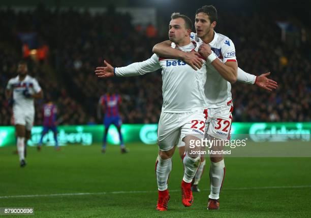 Xherdan Shaqiri of Stoke City celebrates scoring his sides first goal with Ramadan Sobhi of Stoke City during the Premier League match between...