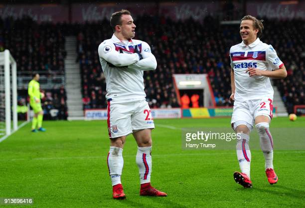 Xherdan Shaqiri of Stoke City celebrates scoring his side's first goal with Moritz Bauer during the Premier League match between AFC Bournemouth and...
