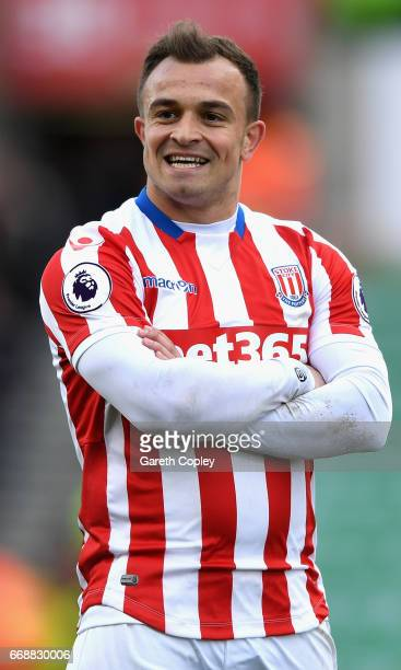Xherdan Shaqiri of Stoke City celebrates scoring his sides third goal during the Premier League match between Stoke City and Hull City at Bet365...