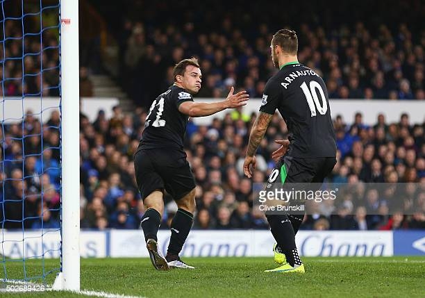 Xherdan Shaqiri of Stoke City celebrates scoring his team's first goal with his team mate Marko Arnautovic during the Barclays Premier League match...